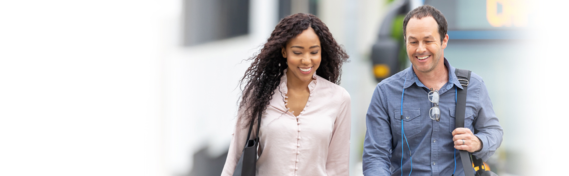 Woman and man walking in street smiling