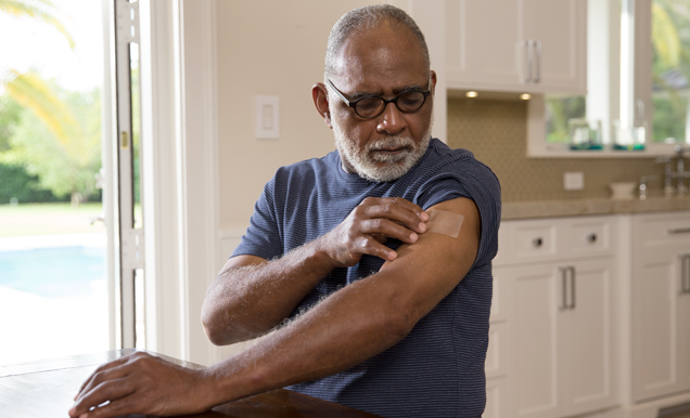Man applying nicotine patch.