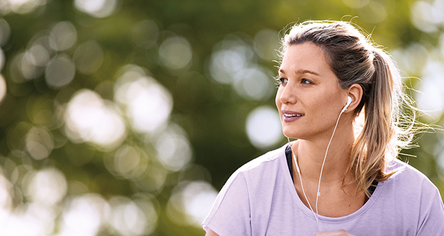 Woman with earphones on