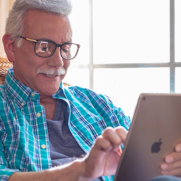 Elderly man using iPad